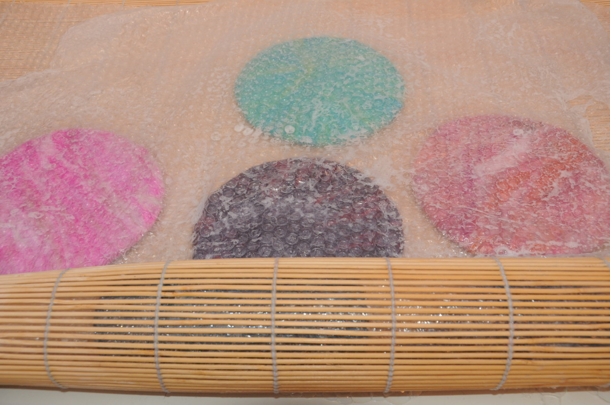 The prepared purses being rolled in a bamboo blind.