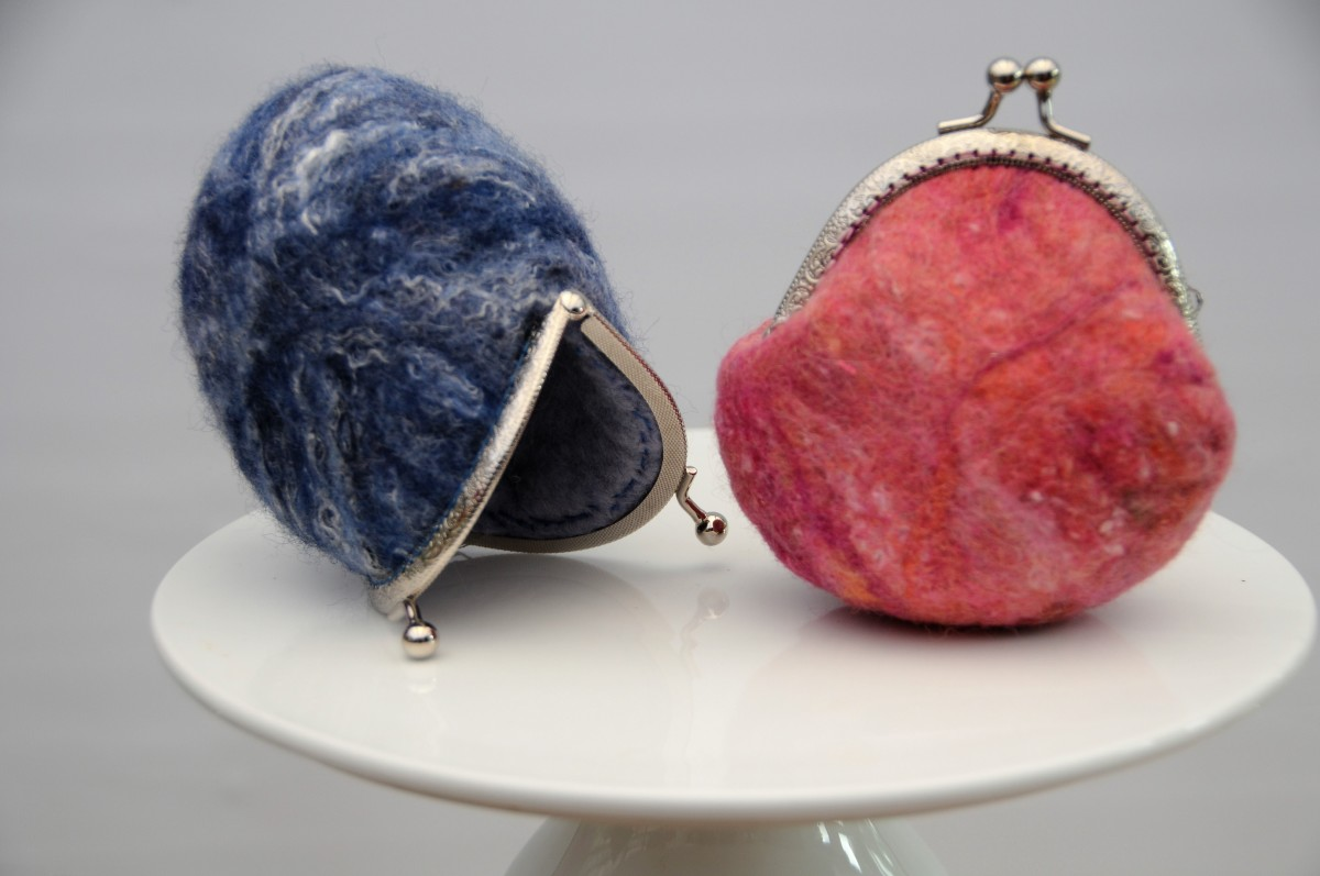 The blue purse shows some of the texture and shine obtained from the Botany Lap Waste fibers.