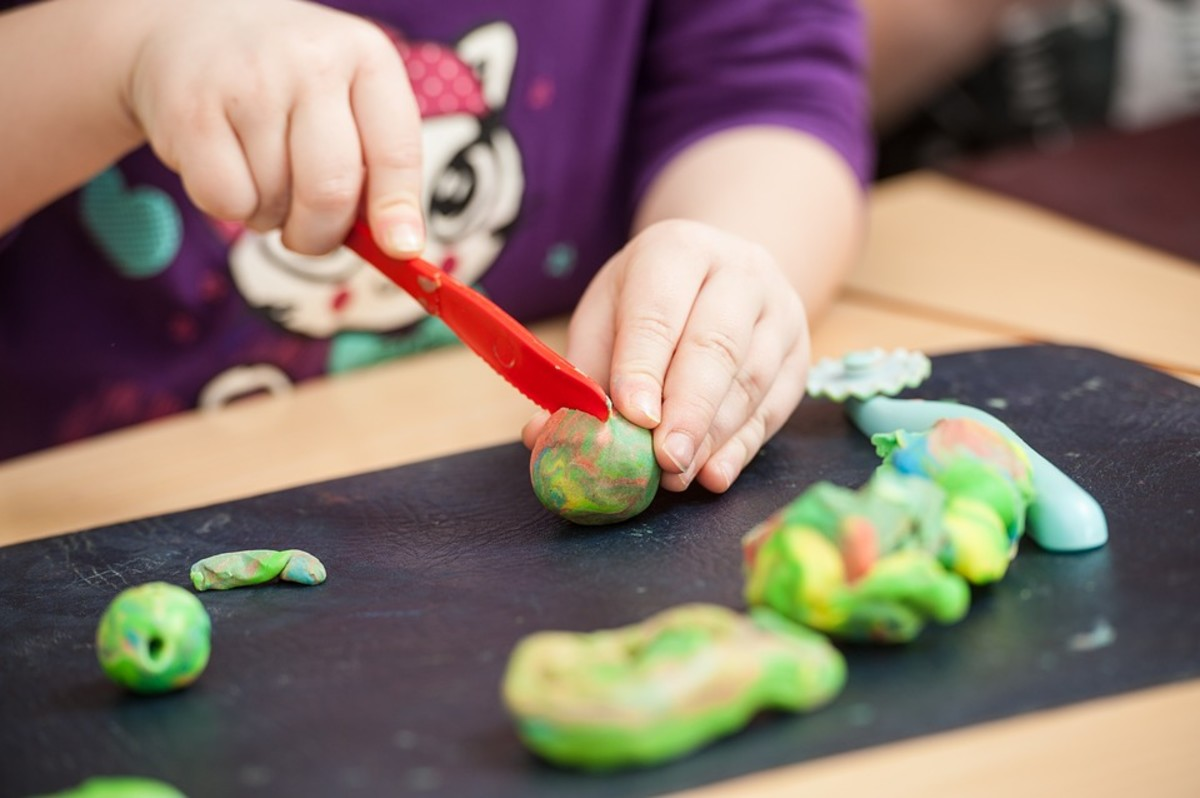 Getting your child involved in making homemade cooked playdough is a great experience for parent and child alike!