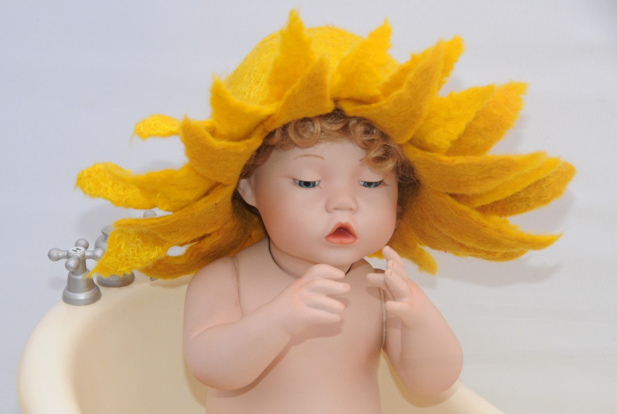 Bathing in a Wet Felted Sunflower Hat.