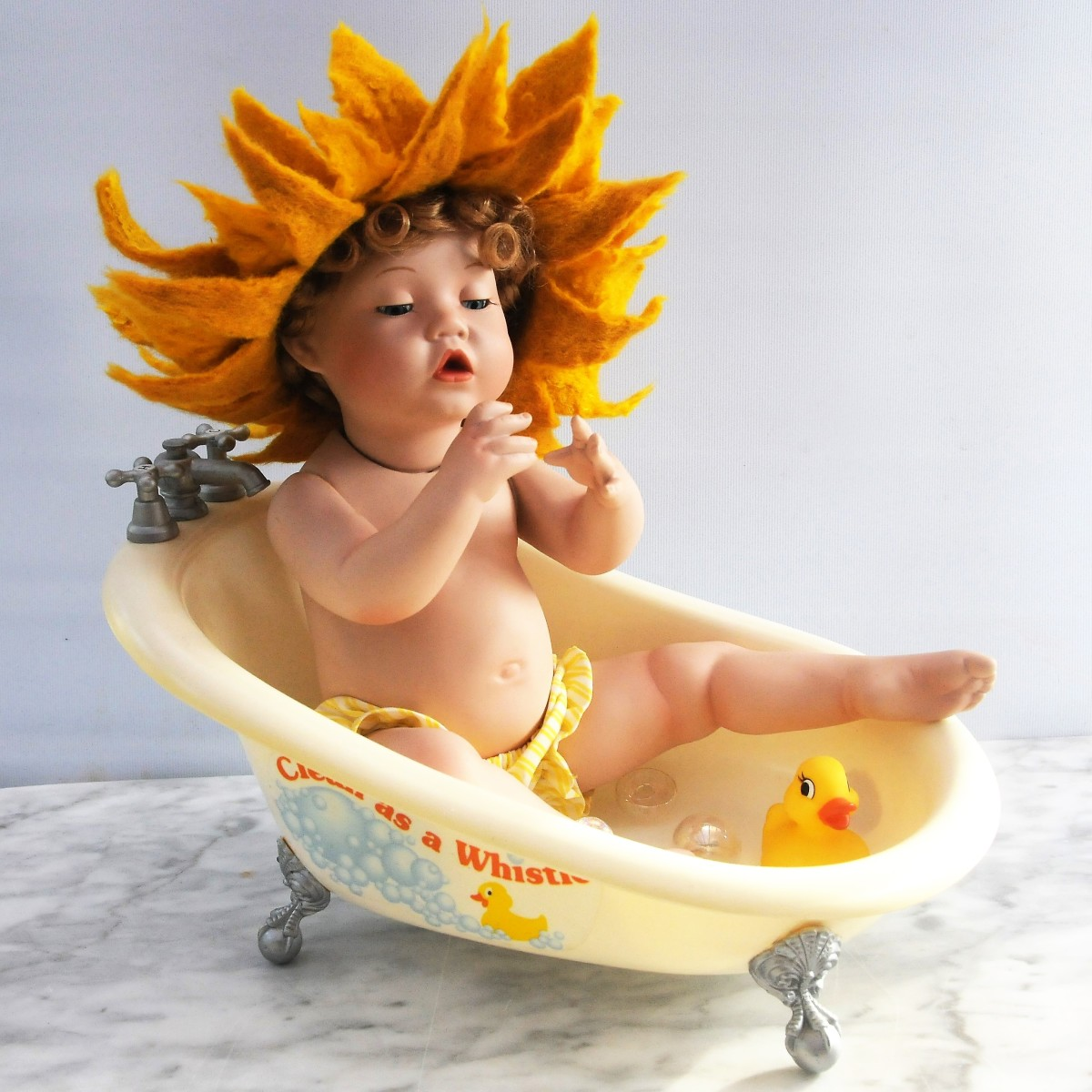 Little Miss Sunshine, bathing in a wet felted sunshine hat.