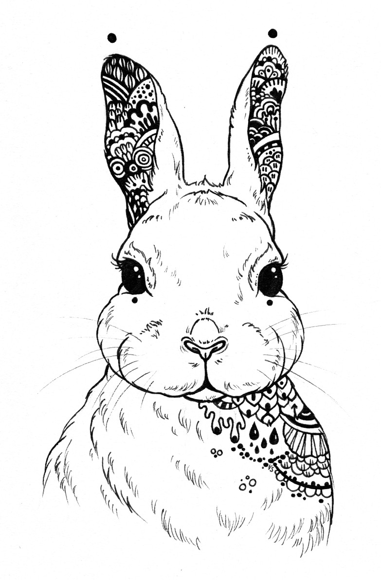 This hare has a mandala-inspired pattern on its chest and in its ears.