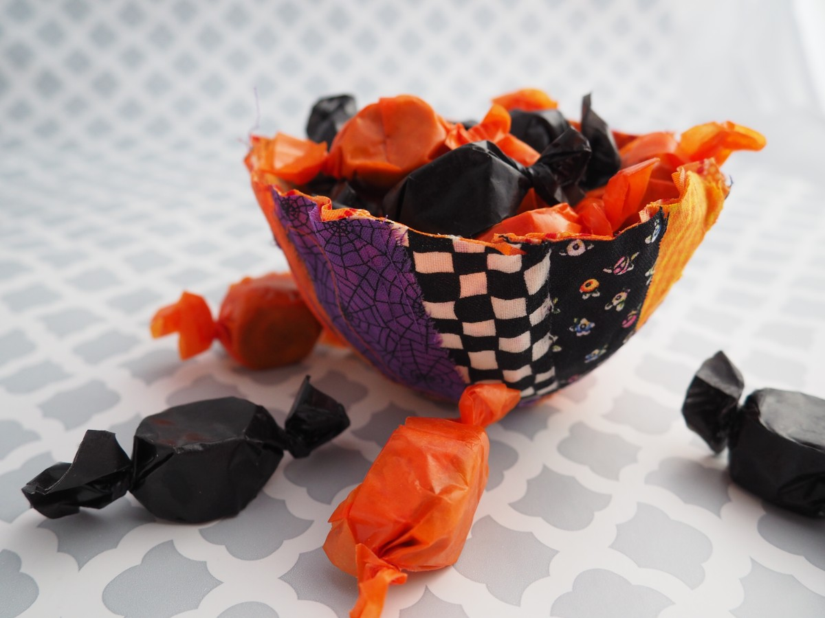Fill the bowls with wrapped candies or other fun party trinkets.