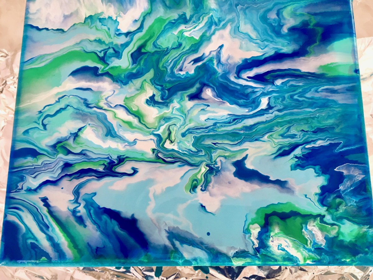 The wet paint flowed and blended into this abstract water pattern.