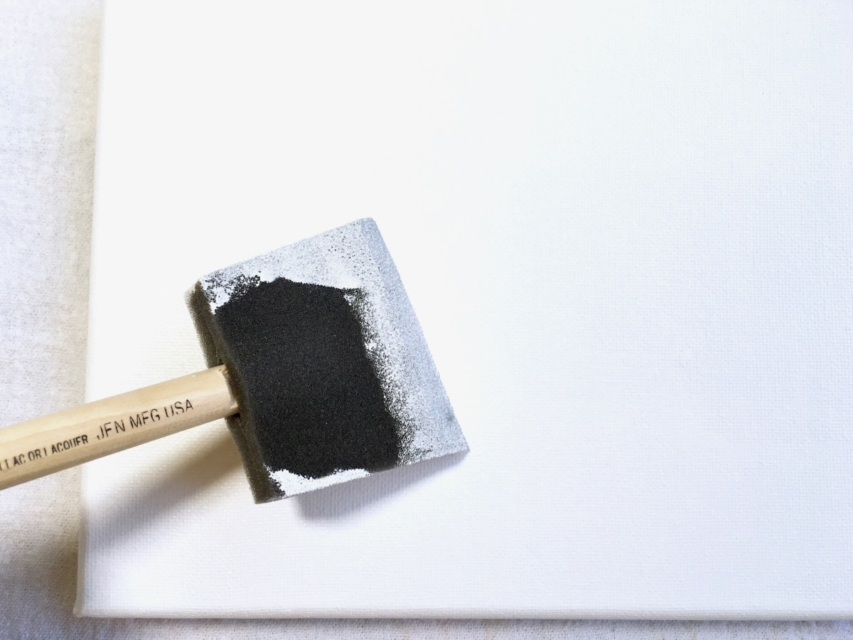 A 2-inch polyfoam brush is an easy way to apply gesso to a canvas.