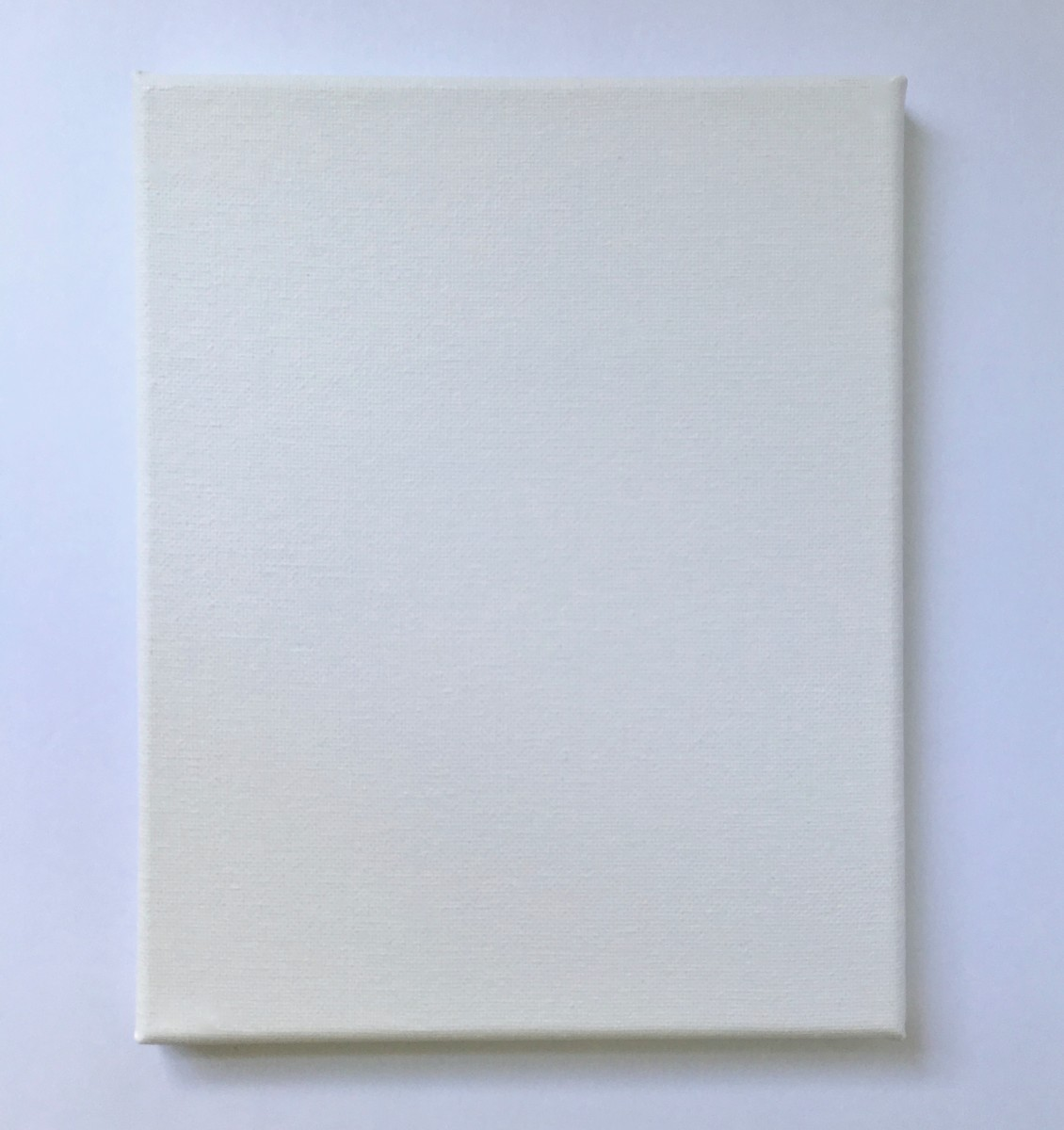 A stretched canvas for pour painting.