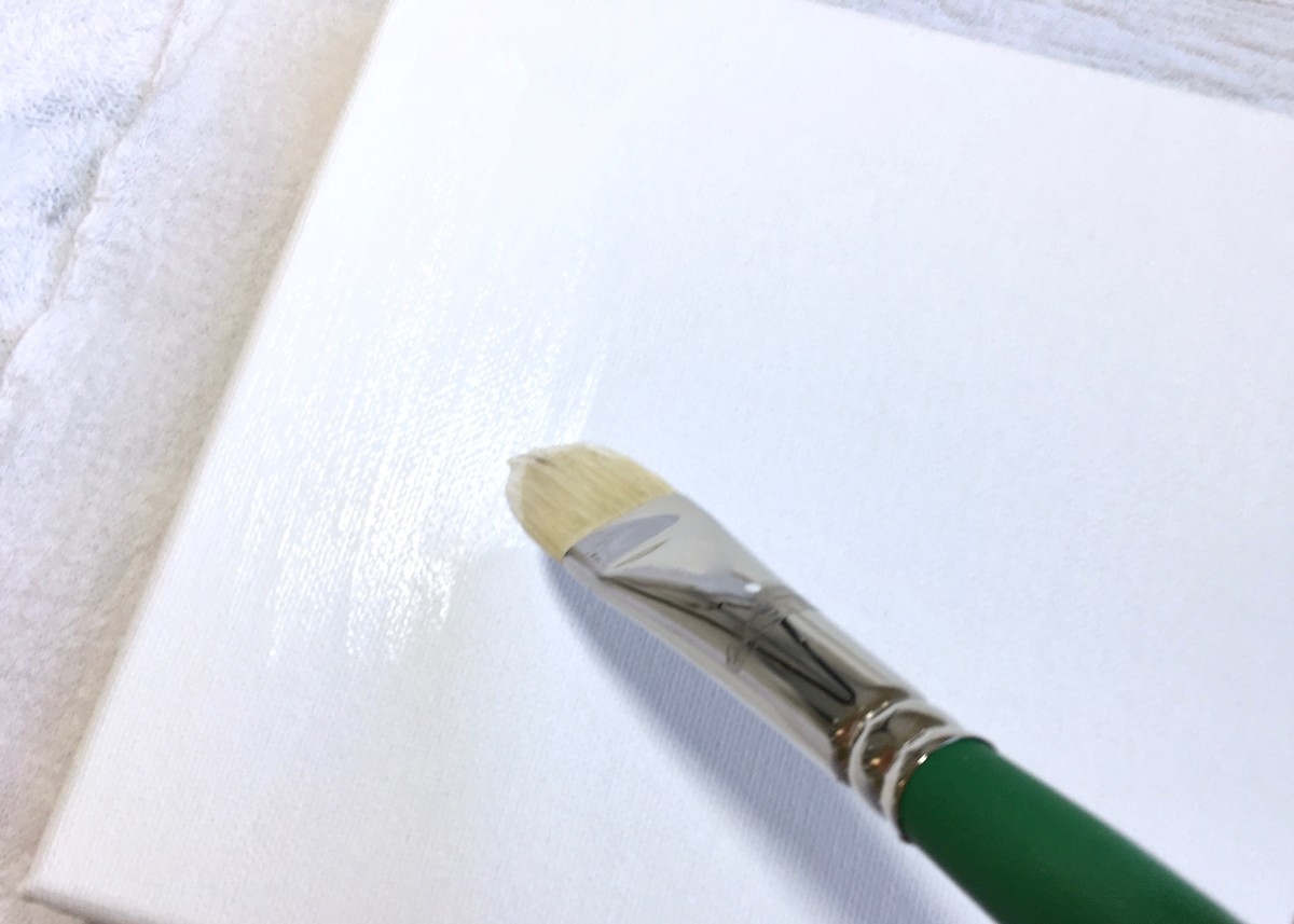 A flat paint brush can also be used to apply gesso.