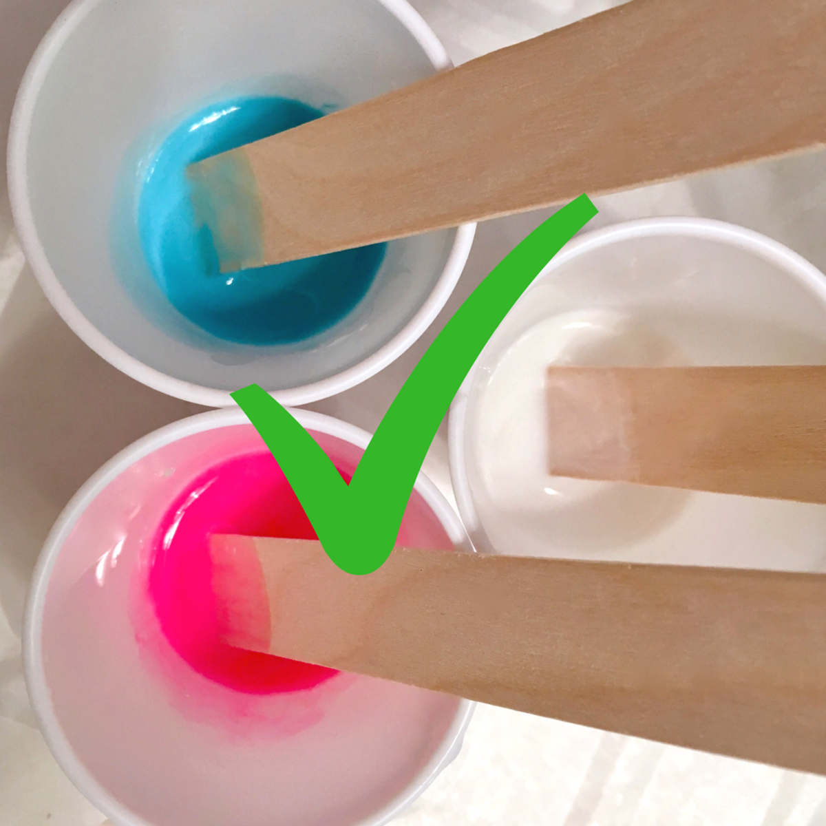 Slowly stirring your paints and pouring medium with a wood craft stick will blend the colors without adding air bubbles.