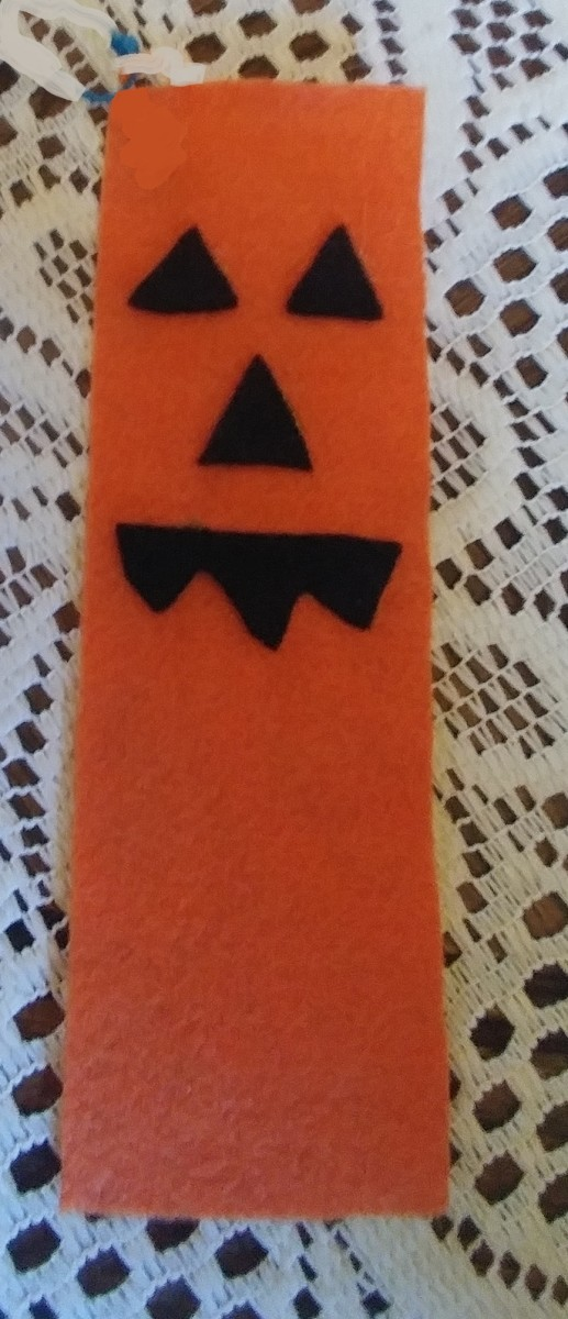 Face glued onto the bookmark.