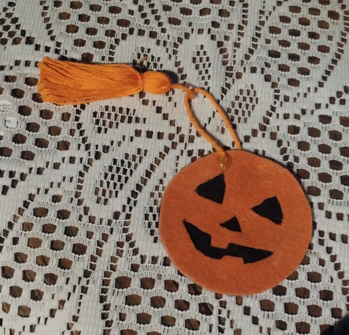 This DIY Jack-o'-Lantern bookmark is a unique addition to a favorite book!