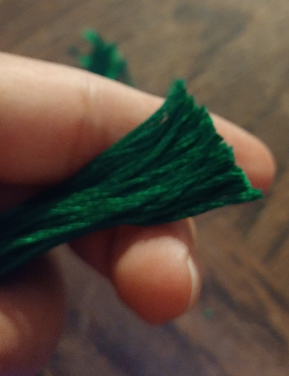 Cut bottom edge of tassel off with scissors. Be sure to cut evenly.