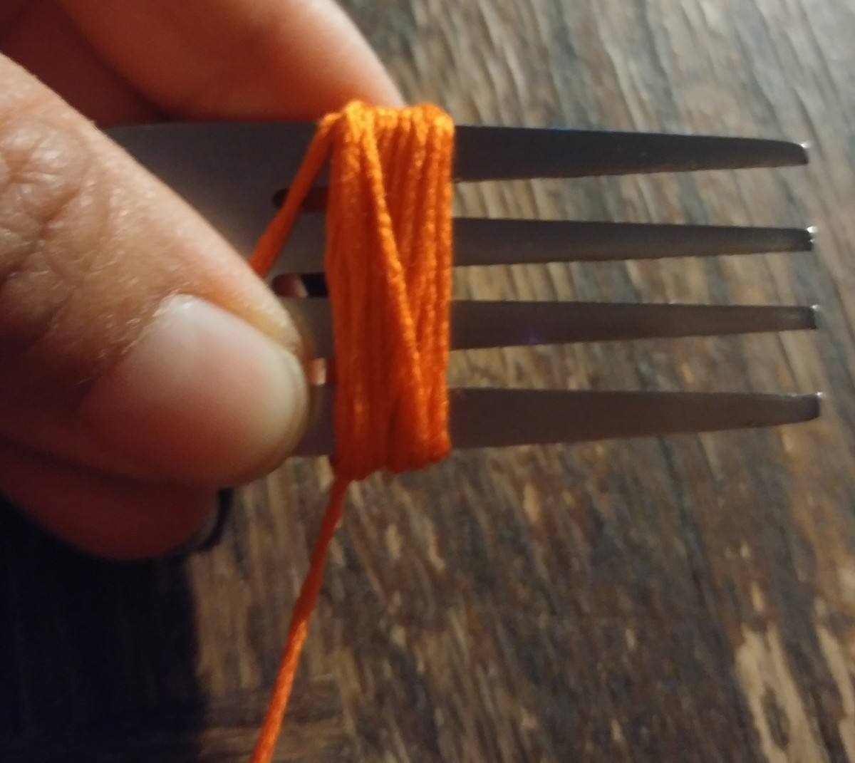 A fork is used to wrap thread around for tiny tassels.
