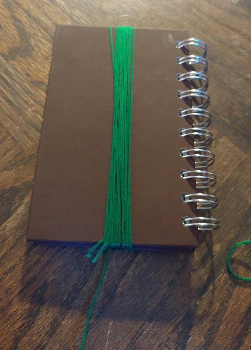Wrap thread around book.