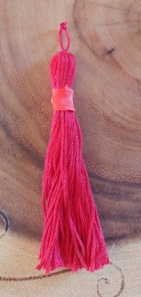 The tassel may have Style! I glued ribbon over the top of wrapped thread, on this tassel.