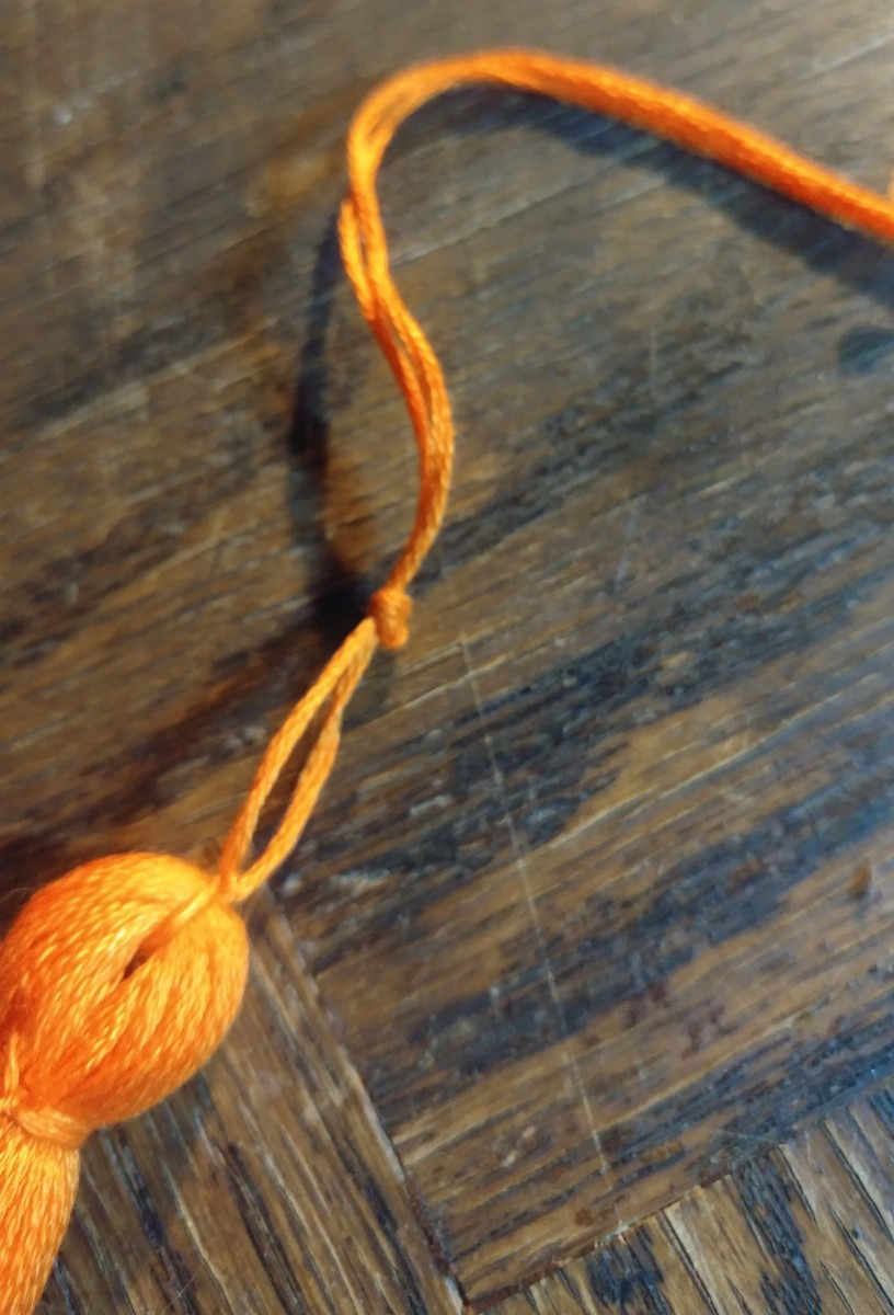 Tie loop at the top of tassel.