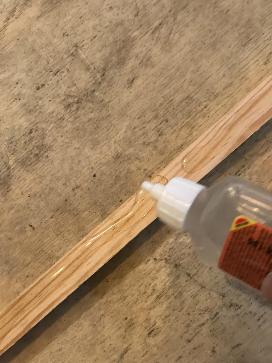 Although you can use nails, Gorilla glue is really easy to apply.  It's also weatherproof and extremely strong!
