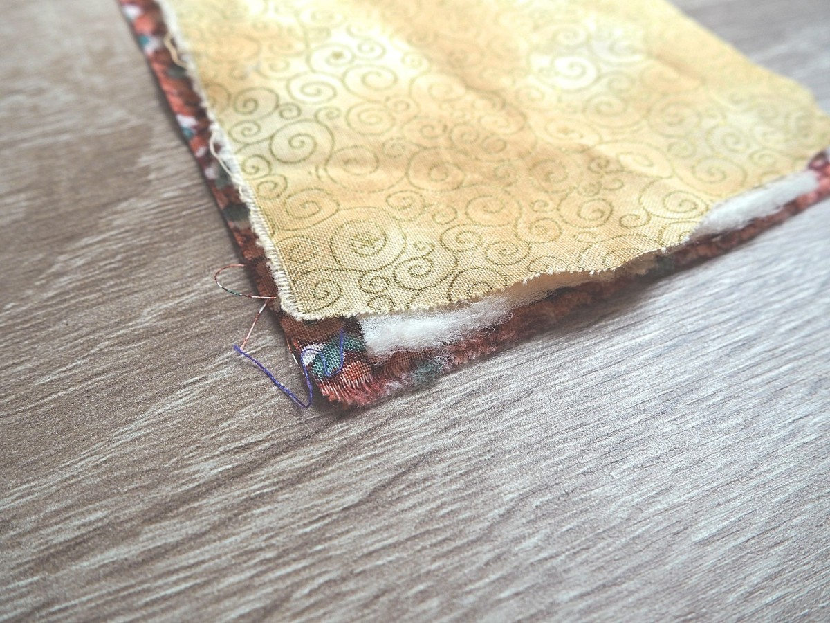 Layer the fabrics and battings to get ready to cut out the leaf.