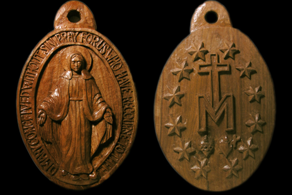 This carving of the Miraculous Medal is on two sides of a walnut panel. On small faces, palm tools are preferred over long-handled tools.