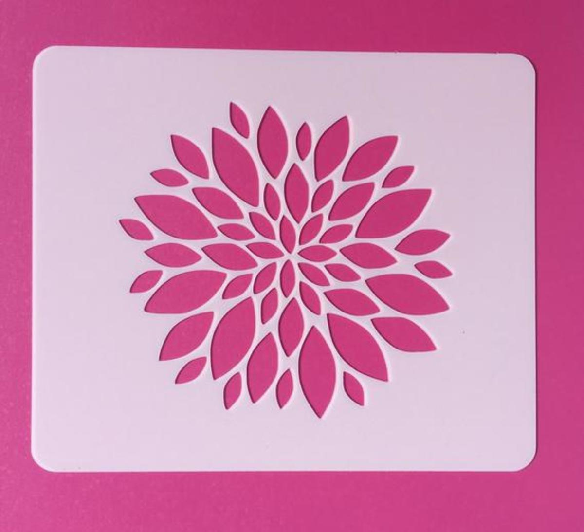 A stencil can be a simple design like this zennia  or a more complicated back ground design