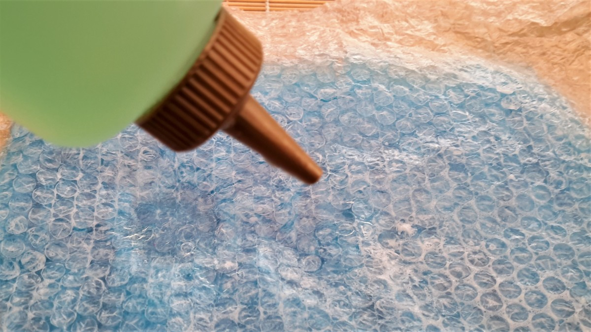 Wet the bubble wrap with warm soapy water