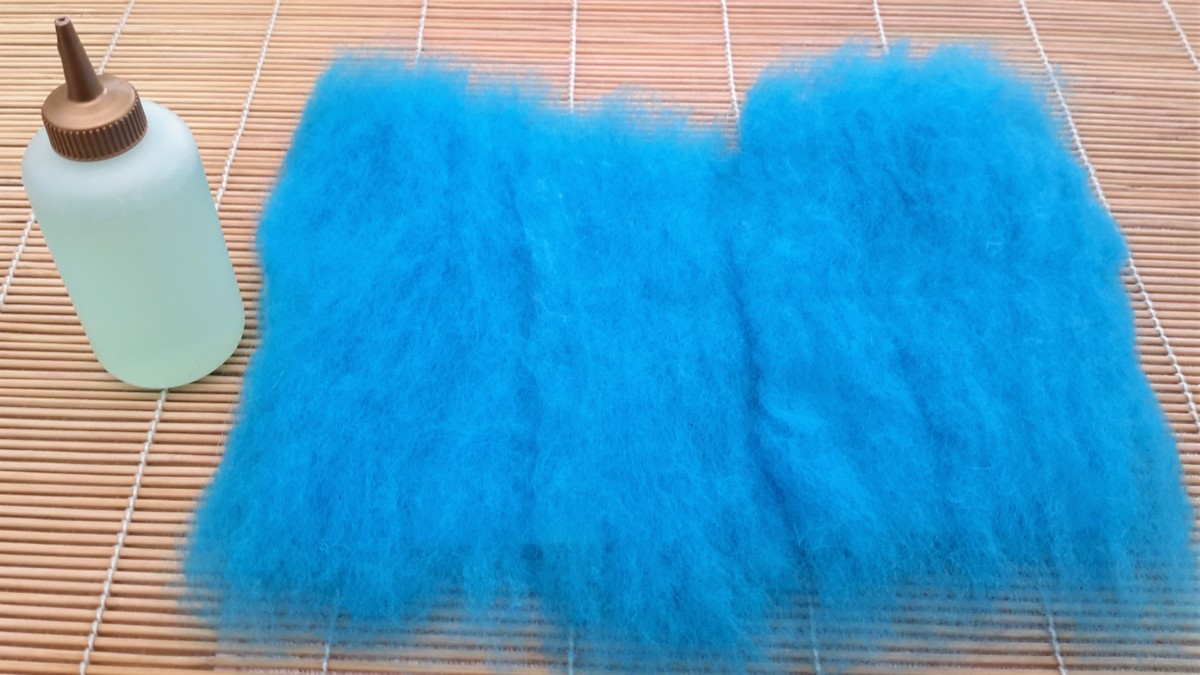 1st Layer of wool roving, opened out to cover the template.