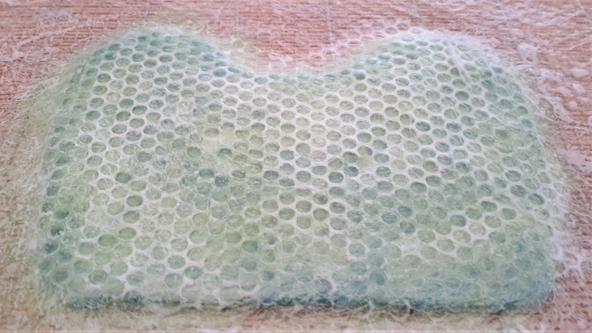 Cover with bubble wrap and rub until the fibers have flattened.
