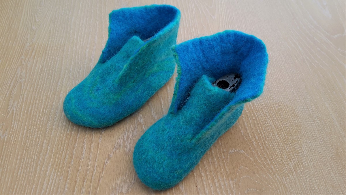 Slipper tongue, still requires more soap and water to seal cut edges and shrink neatly against the shoe lasts.