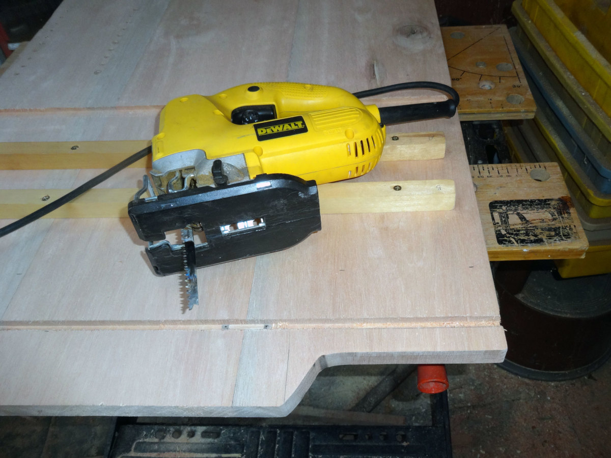 Using jig saw to cut decorative rise in side panels for access to front brake wheels