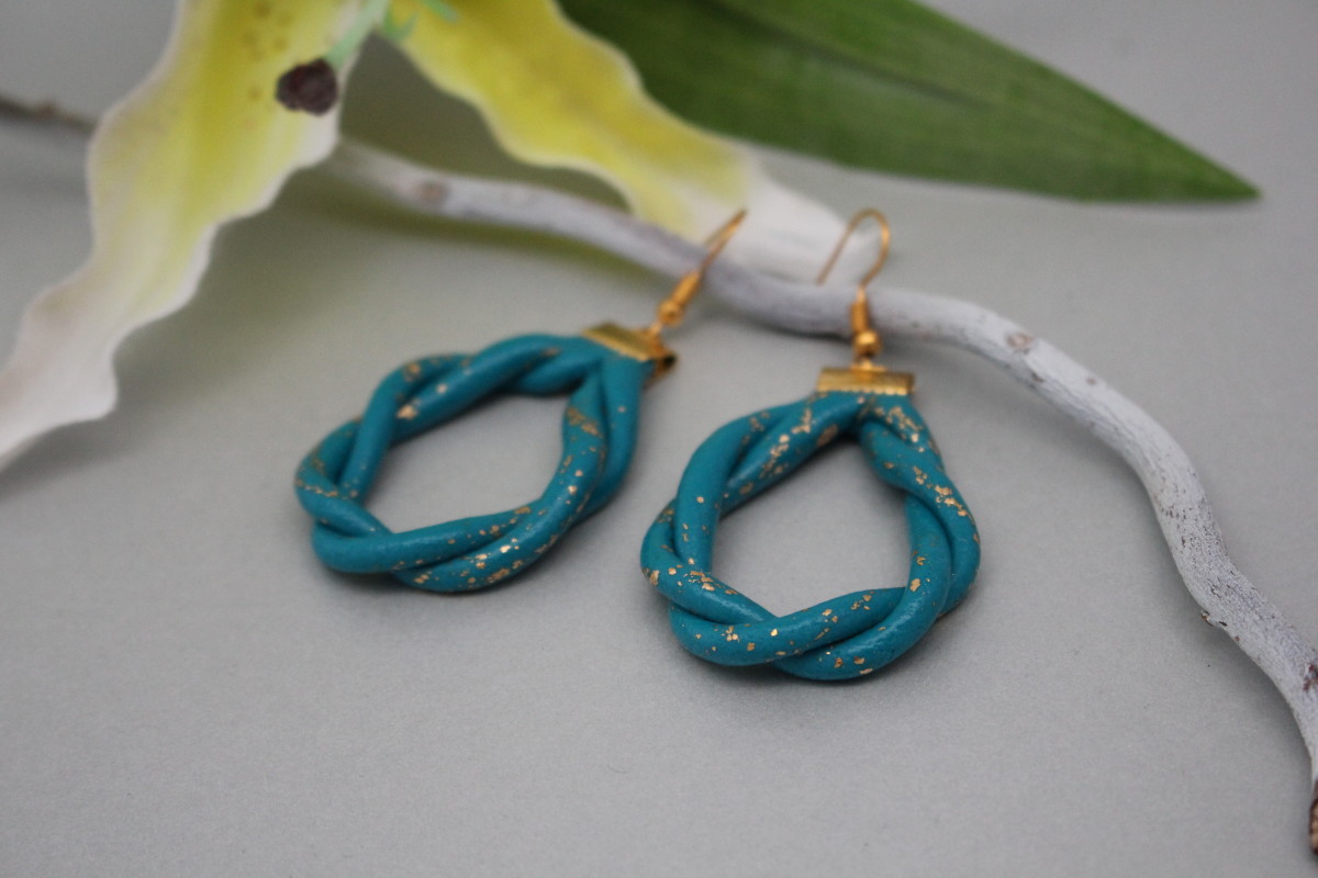 Here I used FIMO Leather in a turquoise color and added a little gold leaves.
