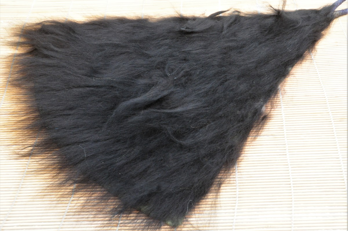 Cover in a layer of black fiber.