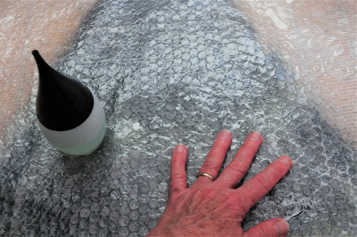 Cover with bubblewrap, wet and rub until fibers are flattened.