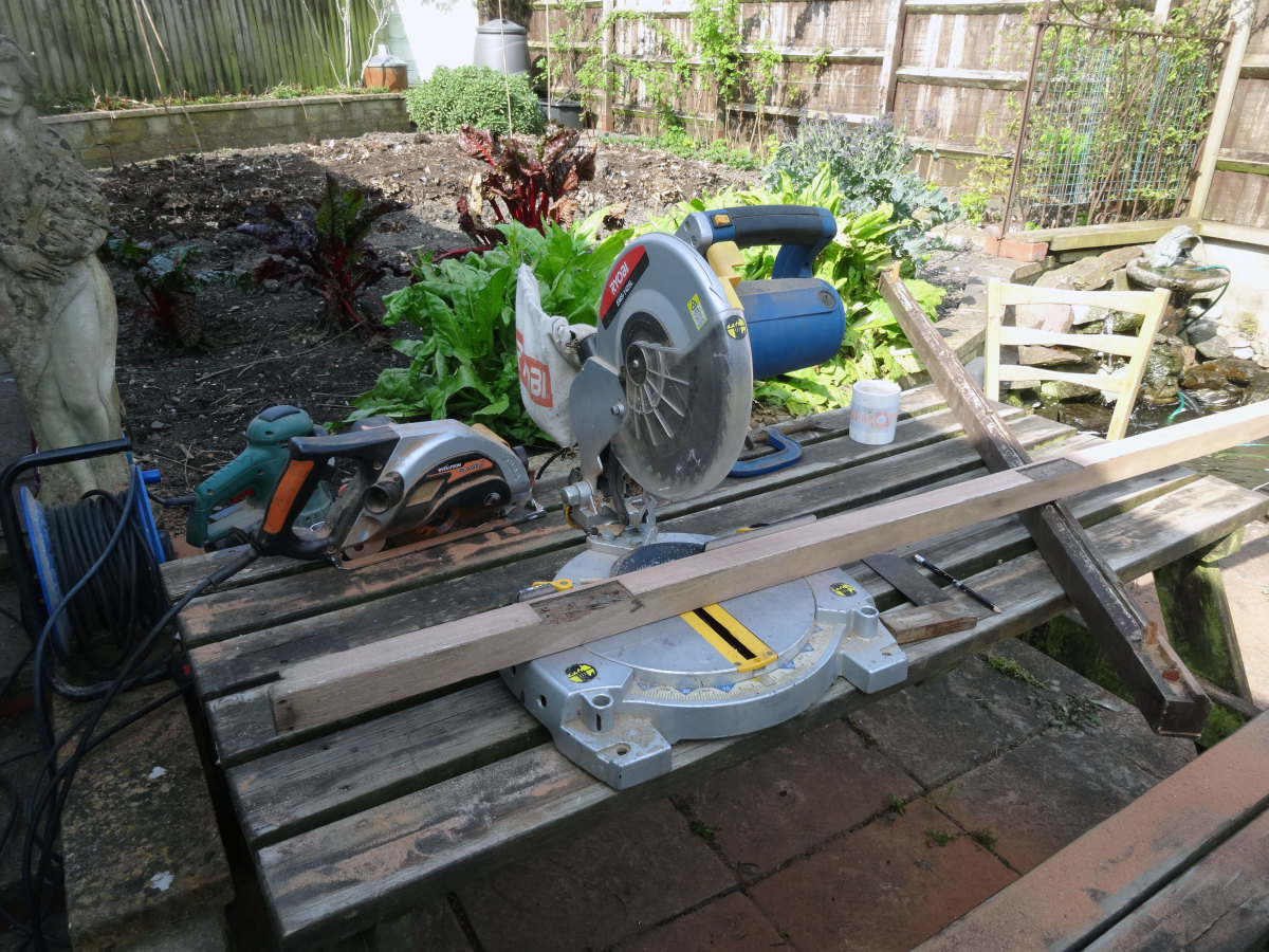 Cutting the wood to required lengths with a mitre saw.