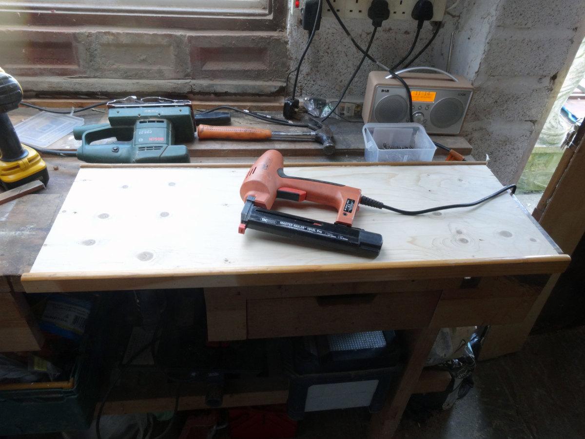 Edging glued and nailed to edge of plywood shelf.