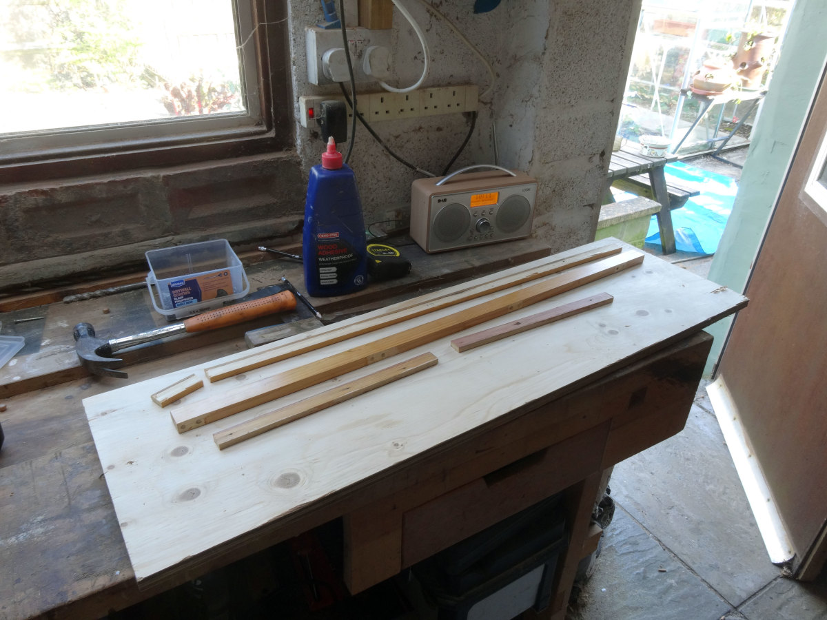 All required bits of salvaged wood ready for assembling, to make under table shelf.