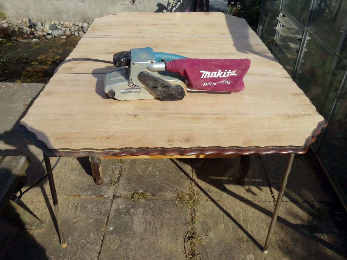 Table top sanded back to bare wood with belt sander.
