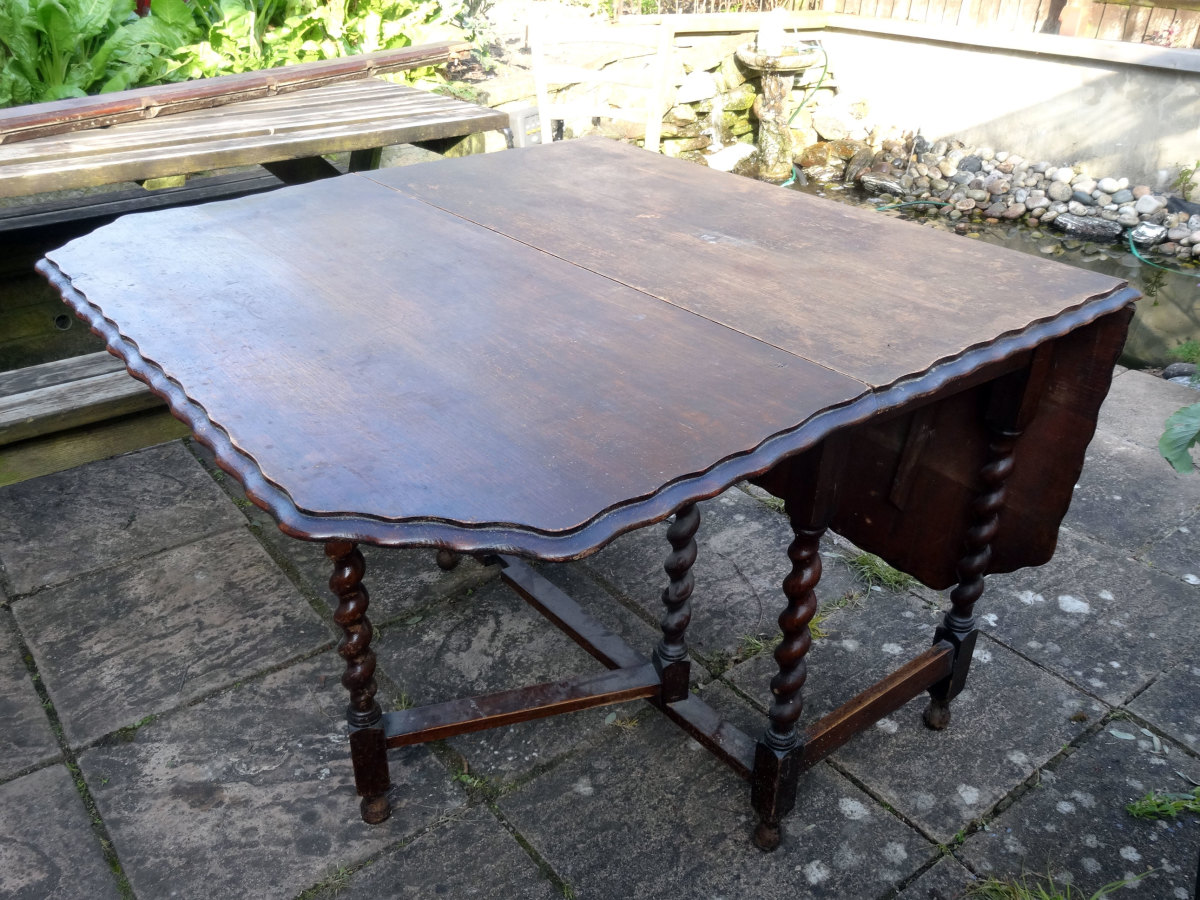 Oak table with one missing gate leg.