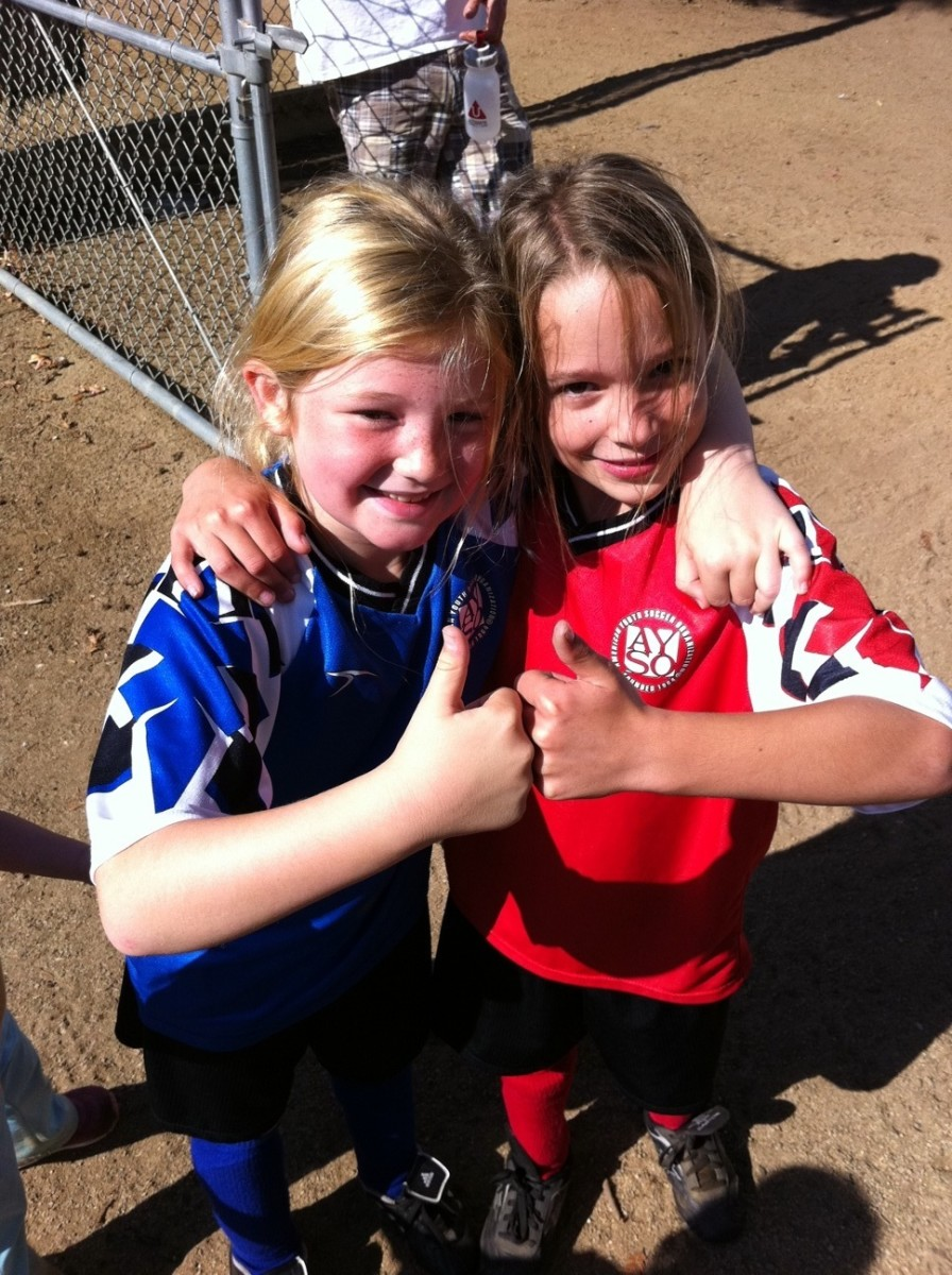 Eight-year-old girls play organized soccer.  Give the gift of encouragement.