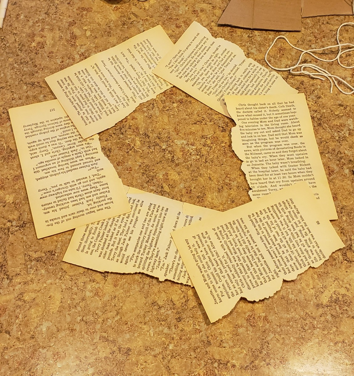 Glue book pages to your cardboard circle.