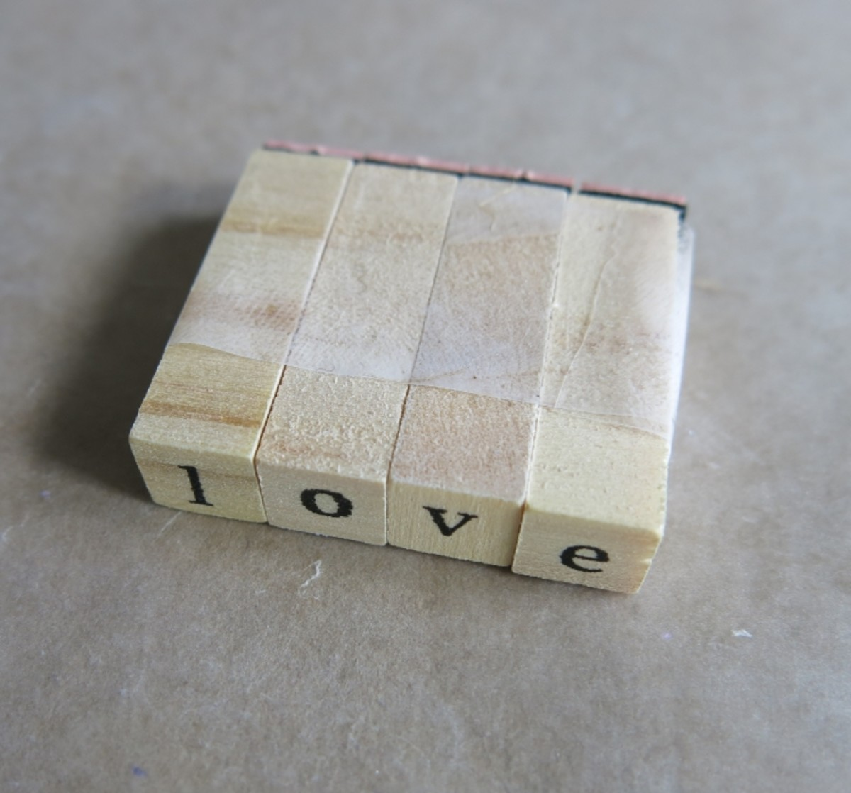 Tape alphabet stamps together to form a word before using
