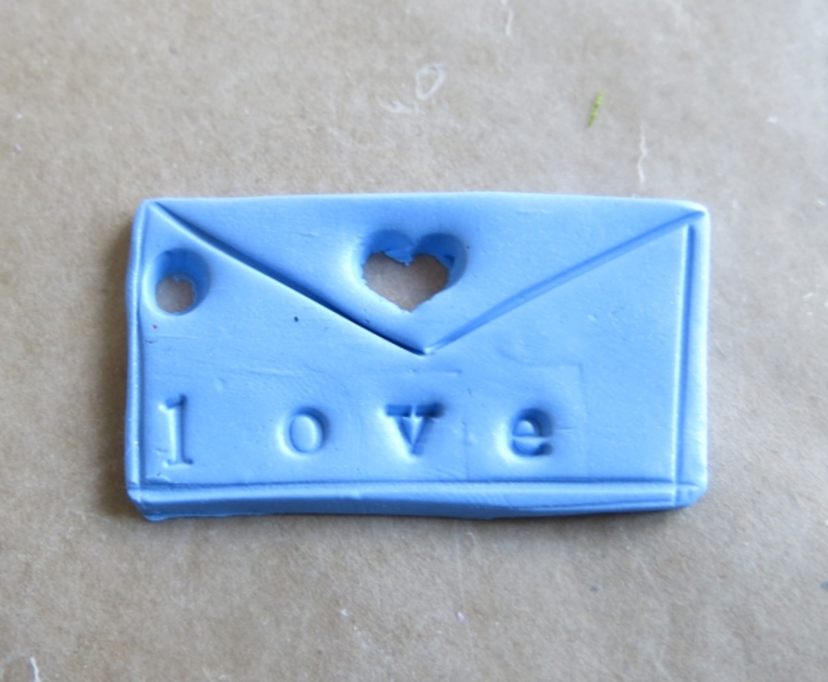 "Stamped and decorated ""love letter"" pendant or charm"