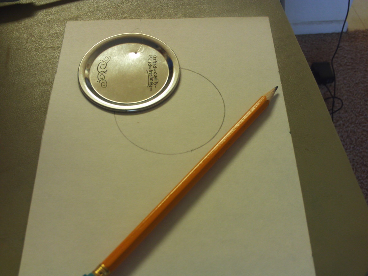 Trace around a canning jar lid with a pencil to make the ornament.