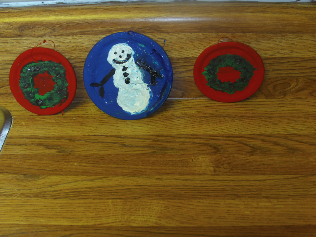 I painted glitter glue over the painted illustrations on the lids.