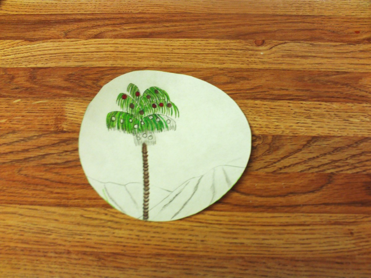 Coloring in the fronds and trunk of the palm tree.