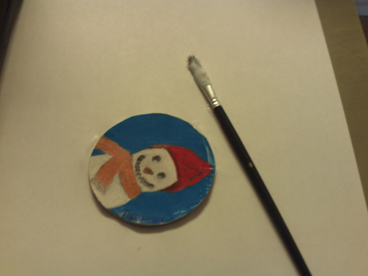 I placed the snowman cut-out on the lid.