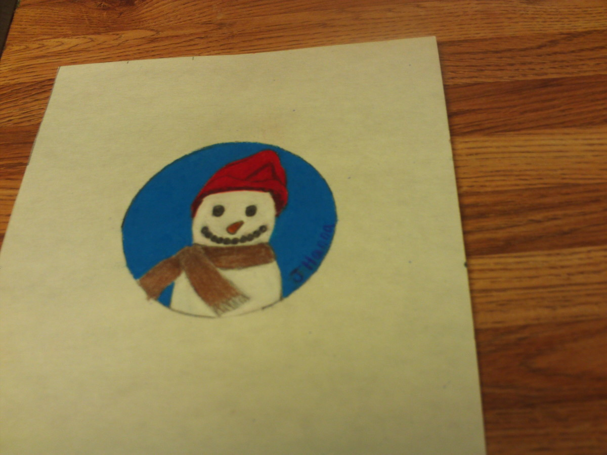 I cut out the snowman drawing once it was completed.
