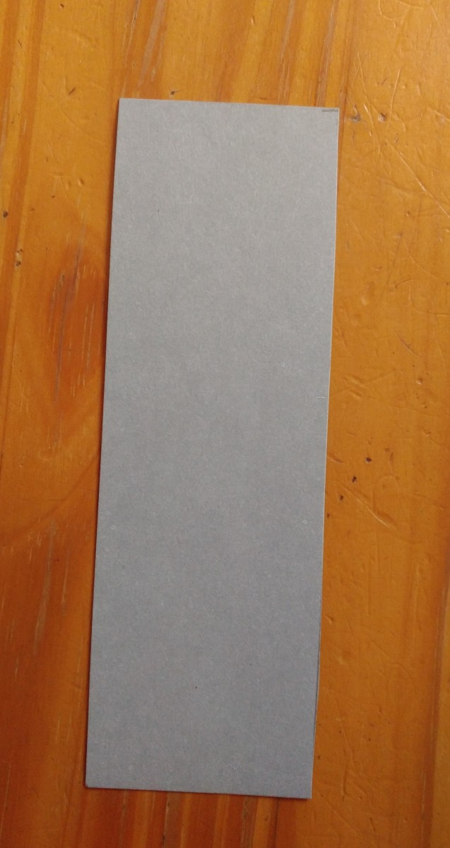 Cut a piece of grey cardstock 7 by 2 inches.