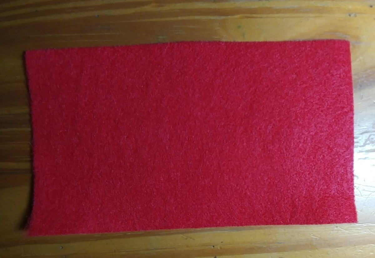 Cut a piece of red felt that is 7 by 12 inches.