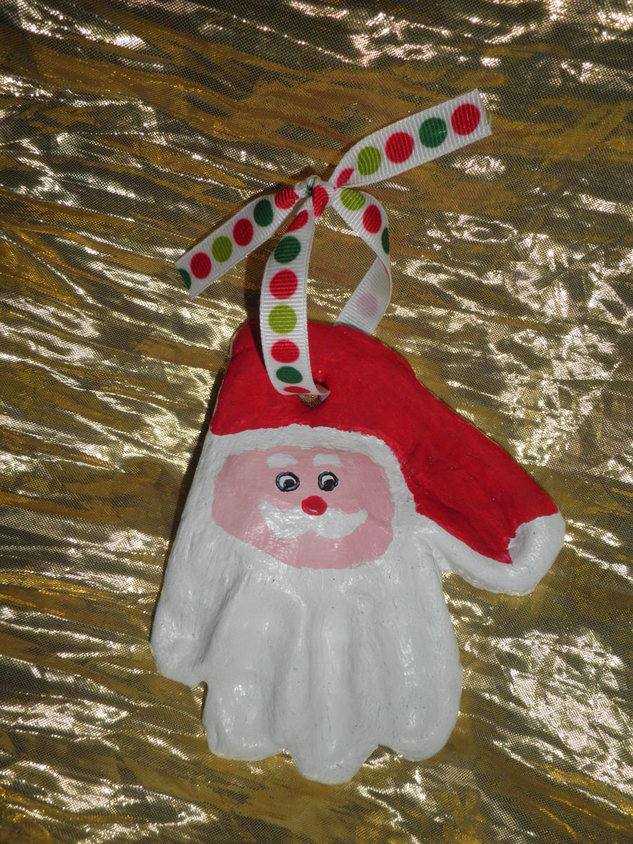 A Santa Ornament from a child's hand print, made out of salt dough clay.