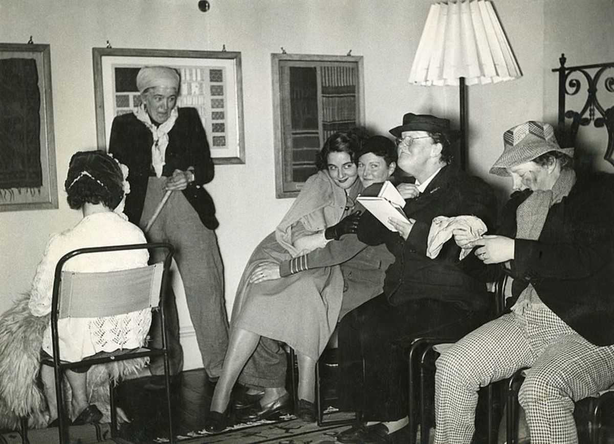 A group of Denman College students are playing a lively game of charades in this 1950s photo.