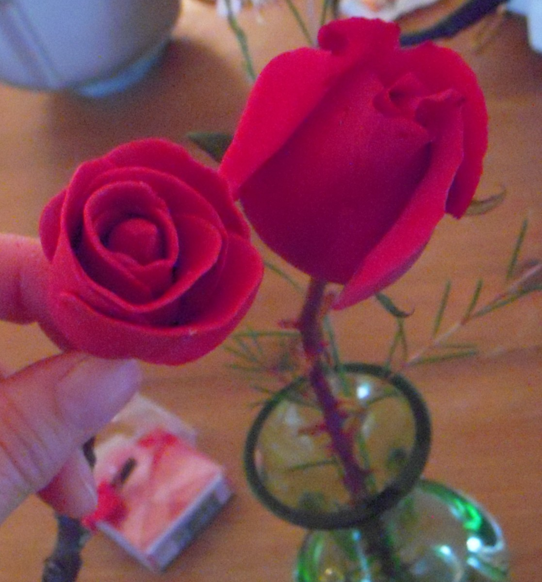 Sculpey clay rose (left) next to the real thing.
